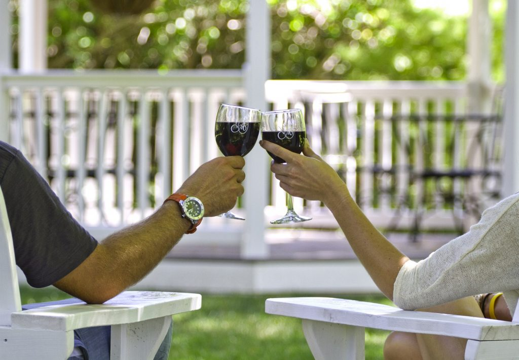 couple drinking wine at the ashbrooke's gazebo