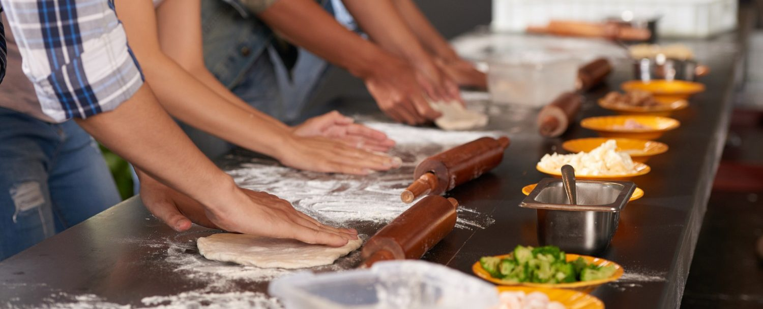 Hands of people making food together